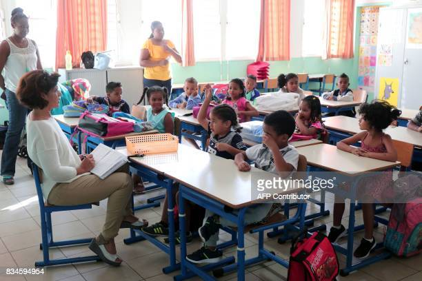 French pupils sit in a classroom at Michel Debre elementary school on the first day of the new school year in SaintDenis de la Reunion on the French...