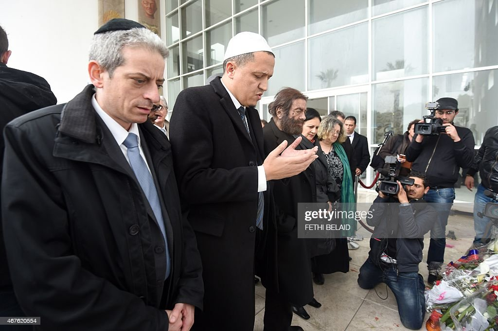 French Rabbi Moshe Lewin, French Imam Hassen Chalghoumi and French-Jewish writer <a gi-track='captionPersonalityLinkClicked' href=/galleries/search?phrase=Marek+Halter&family=editorial&specificpeople=768328 ng-click='$event.stopPropagation()'>Marek Halter</a> pray at the Bardo Museum in Tunis on March 26, 2015, in solidarity with victims of the Tunis' museum attack. Tunisia said that it had arrested 23 suspects in connection with last week's jihadist massacre at the country's national museum.