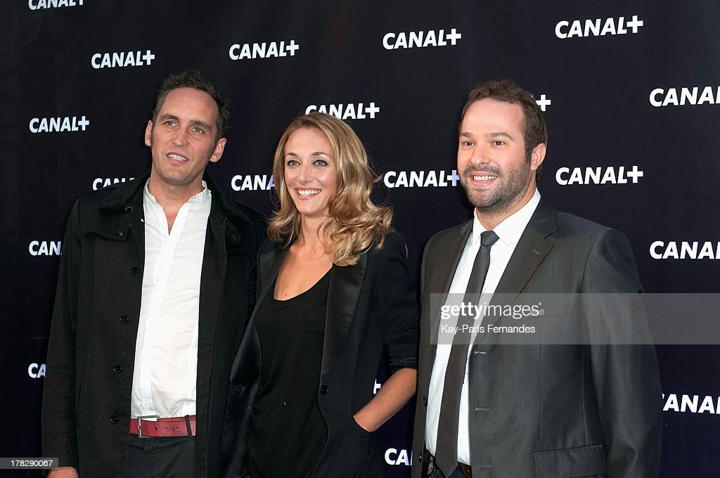 French race car driver Franck Montagny (L), Laurie Lelhostal (c), Julien Febreau (r) , at the 'Rentree De Canal +' photocall at Porte De Versailles on August 28, 2013 in Paris, France.