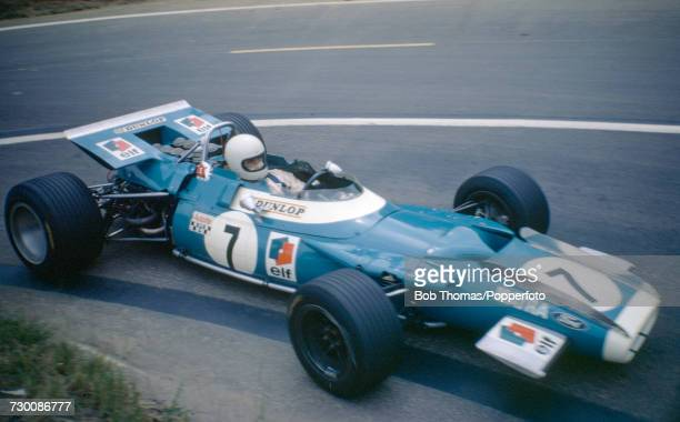 French racing driver JeanPierre Beltoise drives the Matra International Matra MS80 Cosworth V8 to finish in 2nd place in the 1969 French Grand Prix...