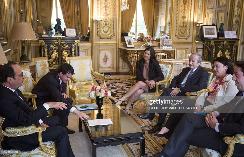 French Radical Party of the Left (Parti Radical de Gauche, PRG) members Sylvia Pinel (2ndR), Guillaume Lacroix (R), Roger-Gerard Schwartzenberg (3rdR) and Virginie Roziere (4thR) speak with French President Francois Hollande (L) and Manuel Valls (2ndL) during a meeting on June 25, 2016 at the Elysee Palace in Paris, after Britain voted to leave the European Union a day before. Europe's press was awash with gloom and doom over Brexit on June 25, warning that it was a boon for nationalists while urging EU leaders to meet the challenge of their 'rendezvous with history'. / AFP / POOL / GEOFFROY