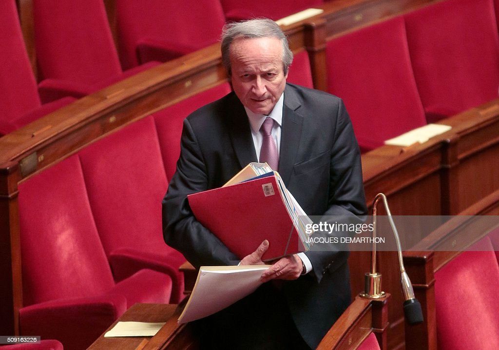 French Radical Party of the Left (PRG) MP Roger-Gerard Schwartzenberg arrives at the French National Assembly in Paris on February 9, 2016, as French lawmakers examined proposed changes to the constitution. France's lower house of parliament is to vote on plans to enshrine a state of emergency into the constitution, including a controversial measure to strip French nationality from those convicted of terrorism and serious crimes. / AFP / JACQUES DEMARTHON