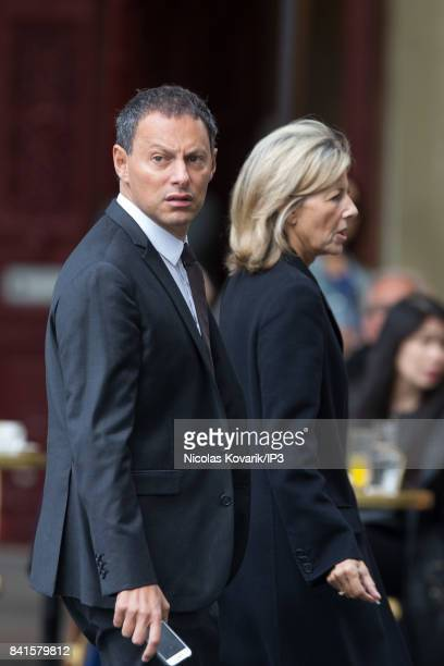 French radio and television host Marc Olivier Fogiel and French Journalist Claire Chazal attend Mireille Darc's Funeral at Eglise Saint Sulpice on...