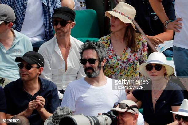French radio and television host MarcOlivier Fogiel and French actress Emmanuelle Beart and her partner Frederic attend the final tennis match...