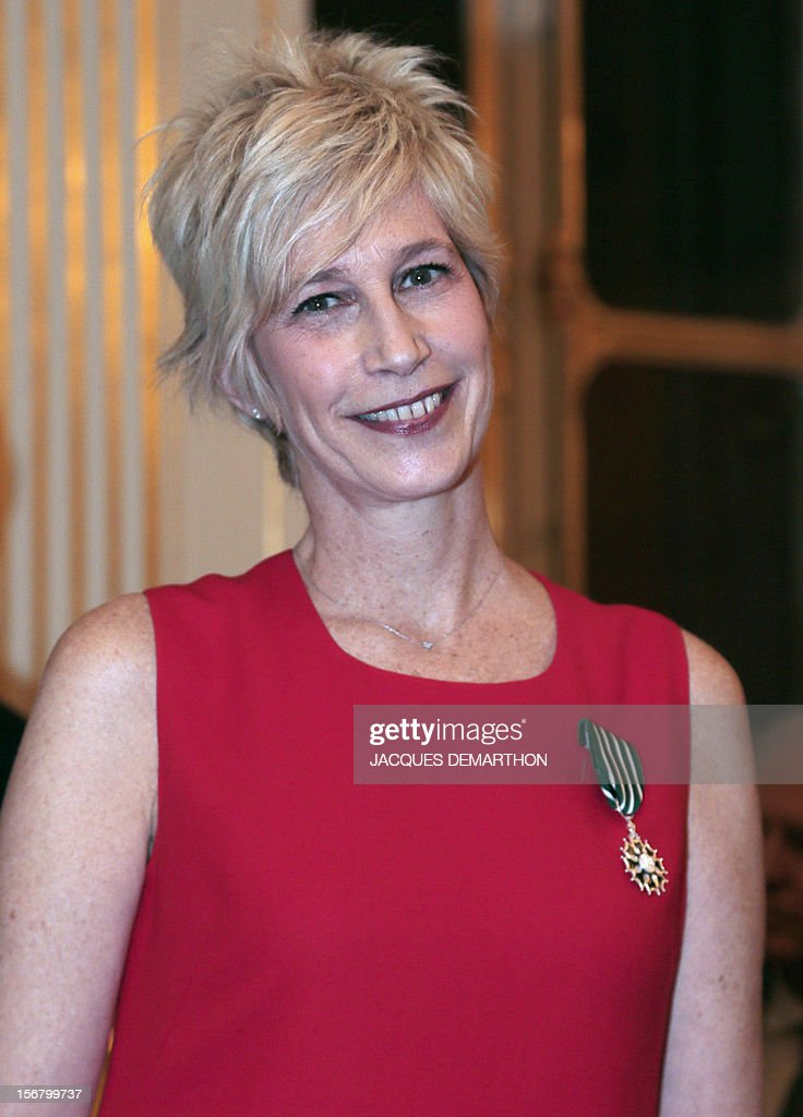 French radio host and former singer Valli poses on November 21, 2012 after receiving the knight of the Order of Arts award during a ceremony at the Culture Ministry in Paris.