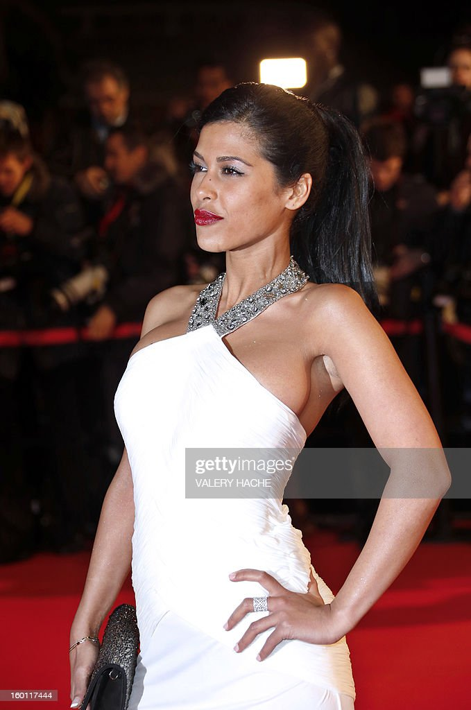 French radio host Ayem Nour poses upon arrival at the Palais des Festivals during the 14th Annual NRJ Music Awards on January 26, 2013 in Cannes, southeastern France. News that the global music industry has finally turned the corner and is on the road to recovery should help get the annual four-day gathering of many of the world's top music execs at the MIDEM trade fair that opens here Saturday off to a good start.