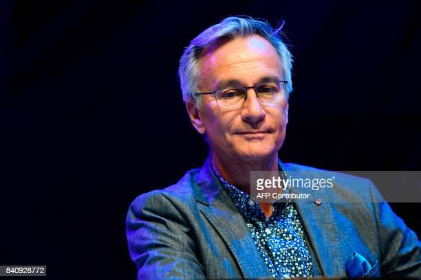 French radio host for France Bleu Laurent Petitguillaume attends a press conference held at the start of the 2017/2018 season at the French public...