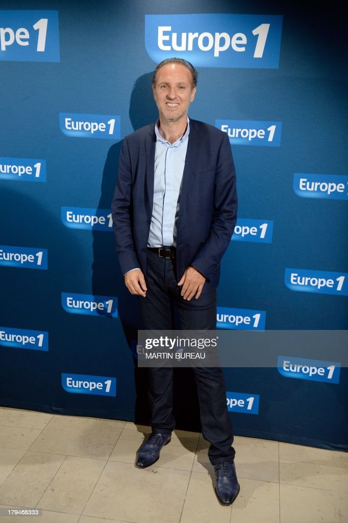 French radio host Patrick Roger poses during a photocall as part of the presentation of the 2013/2014 programs of the Europe 1 radio station, on September 4, 2013 in Paris.