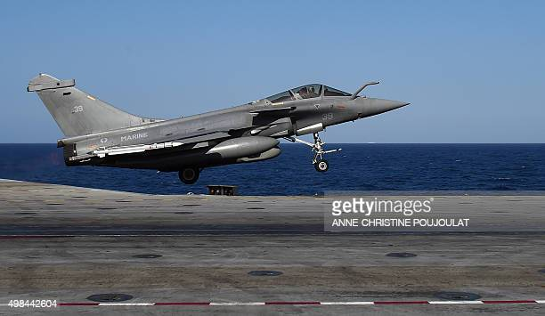 A French Rafale fighter aircraft carrying bombs is catapulted off French aircraft carrier CharlesdeGaulle on November 23 2015 at eastern...