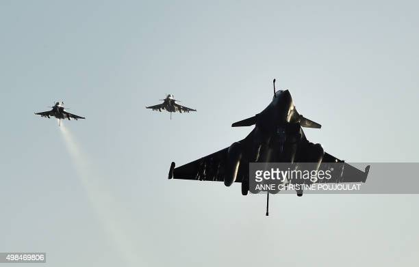 French Rafale fighter aircrafts come back aboard the French CharlesdeGaulle aircraft carrier after flights on November 23 2015 at eastern...