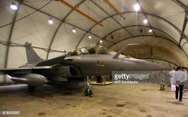A French Rafale fighter jet sits on the tarmac at a military base in Jordan during a visit of the French defence minister on July 18 2017 / AFP PHOTO...