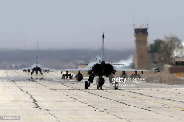 French Rafale fighter jets prepare to take off from a military base in Jordan during a visit of the French defence minister on July 18 2017 / AFP...