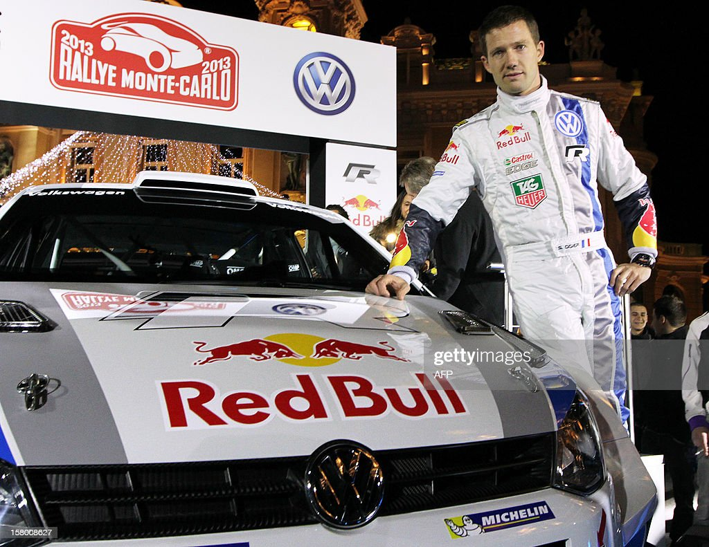 French rallye driver Sebastien Ogier poses in front of his new car, a Volkswagen Polo R, on December 8, 2012, during its presentation in Monaco. Sebastien Ogier of France and Jari-Matti Lavala of Finland will start the WRC Championship with their Volkswagen Polo-R at the Monte Carlo rallye in Monaco, from January 17 to 20, 2013.