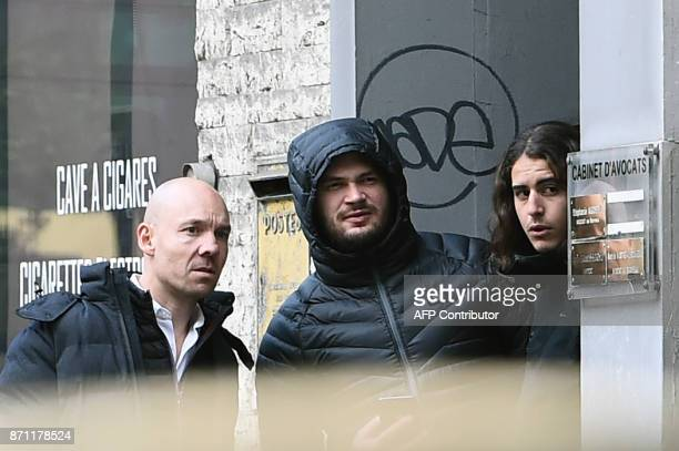 French rap singer Jul whose real name is Julien Marie leaves his lawyer's office along with his lawyer Damien Benedetti on November 7 2017 in...
