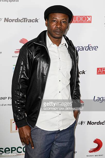 French rap singer MC Solaar poses for photographers during a photocall for the gala evening of the association 'Fete le Mur' created by French former...