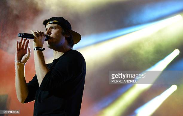 French rap singer Orelsan performs onstage during the Urban Peace 3 hiphop concert on September 28 2013 at the Stade de France in SaintDenis near...
