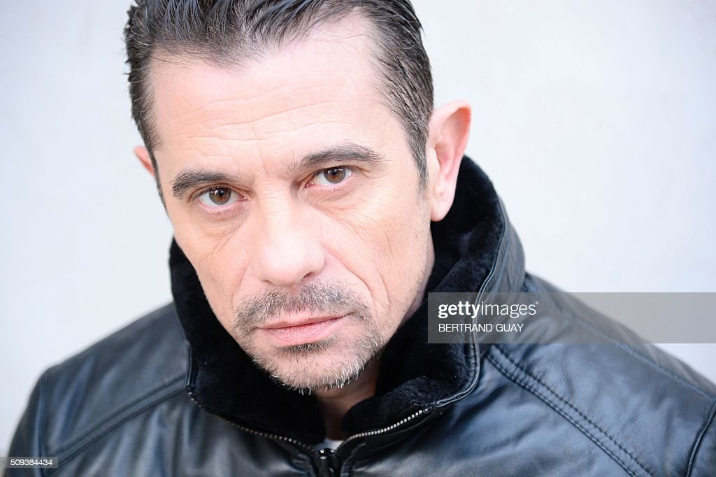French rapper and former co-founder of French rap band 'Supreme NTM' Bruno Lopes, aka Kool Shen poses on February 10, 2016 in Paris. / AFP / BERTRAND GUAY