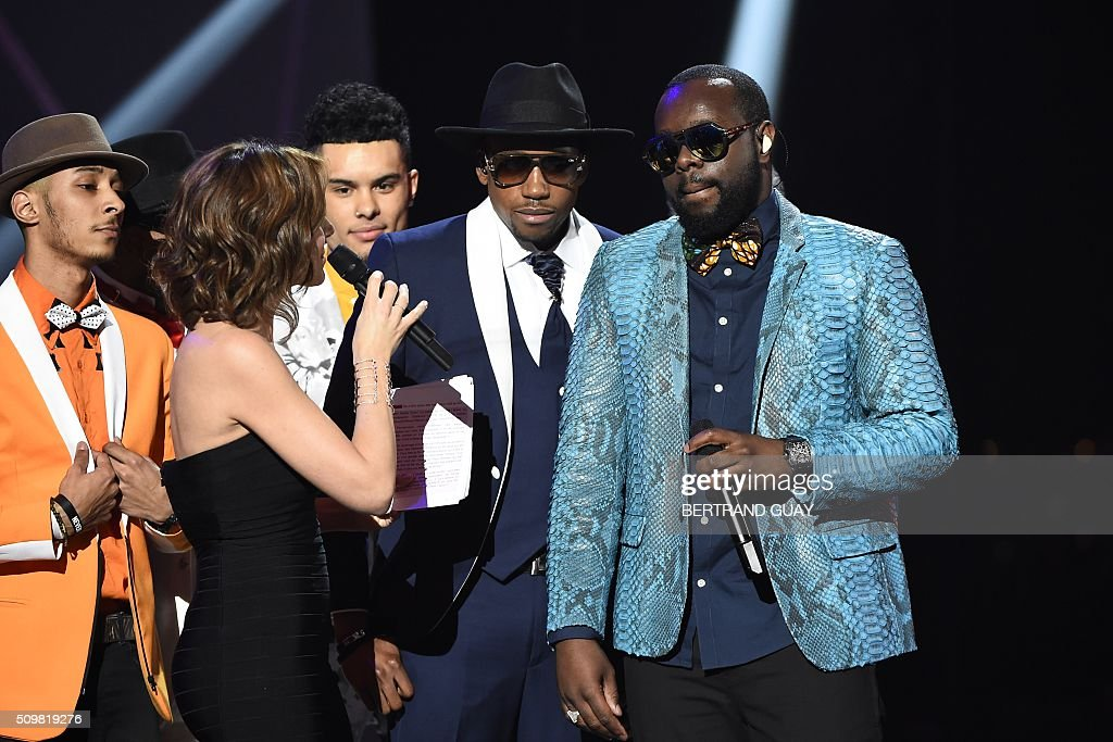 French rapper Gandhi Djuna aka Maitre Gims (R) and French TV host and Master of Ceremony Virginie Guilhaume (L) speak during the 31st Victoires de la Musique, the annual French music awards ceremony, on February 12, 2016 at the Zenith concert hall in Paris. AFP PHOTO / BERTRAND GUAY / AFP / BERTRAND GUAY