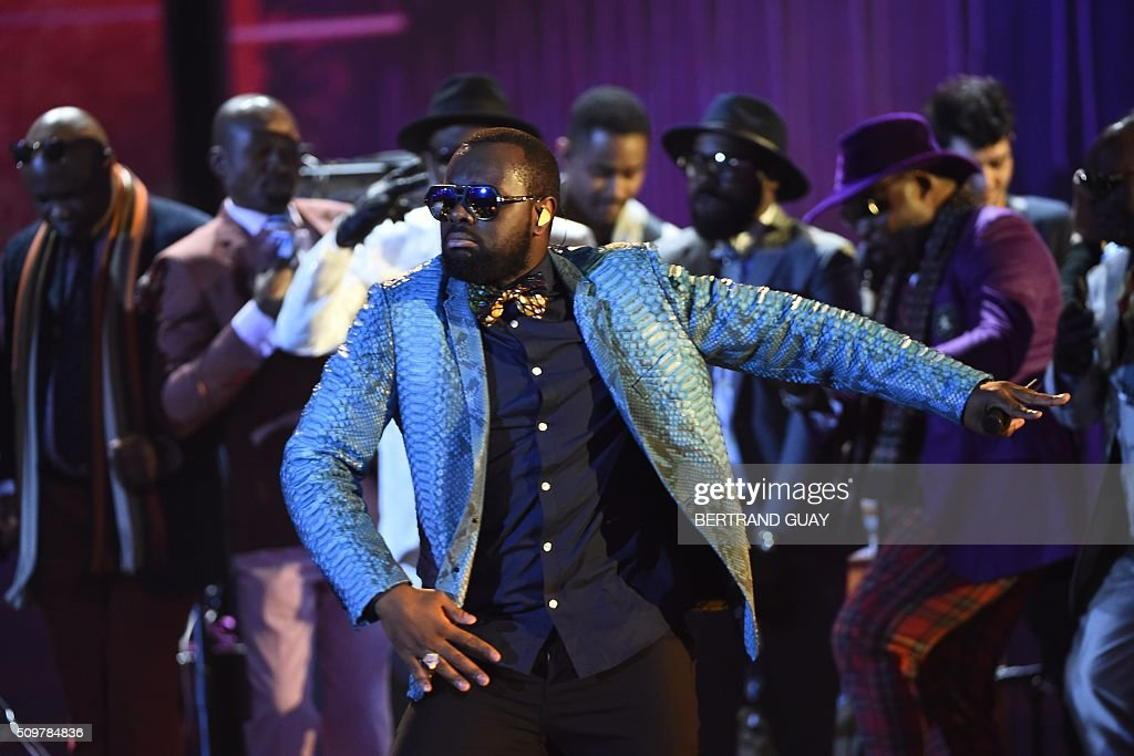 French rapper Gandhi Djuna aka Maitre Gims performs on stage during the 31st Victoires de la Musique, the annual French music awards ceremony, on February 12, 2016 at the Zenith concert hall in Paris. AFP PHOTO / BERTRAND GUAY / AFP / BERTRAND GUAY