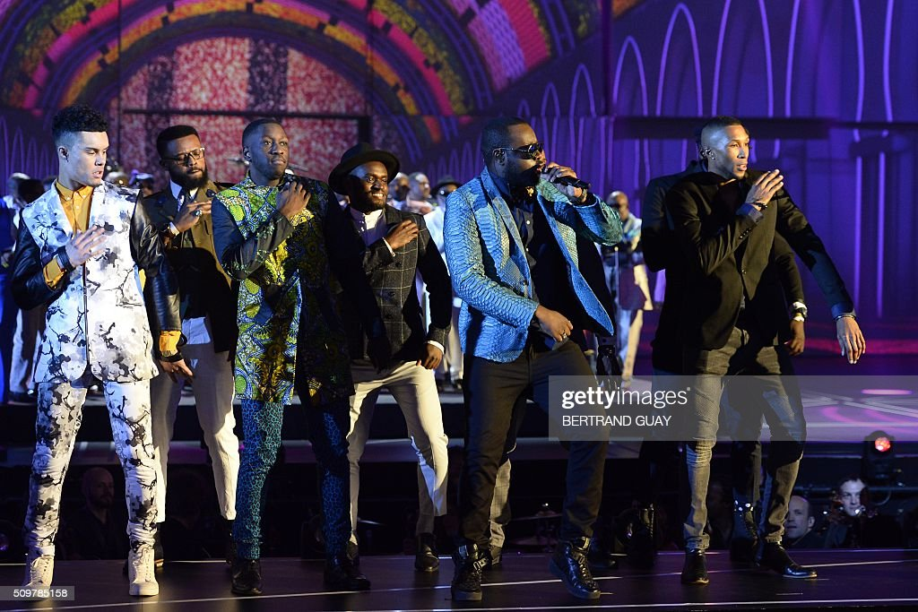 French rapper Gandhi Djuna aka Maitre Gims (2nd R) performs on stage during the 31st Victoires de la Musique, the annual French music awards ceremony, on February 12, 2016 at the Zenith concert hall in Paris. AFP PHOTO / BERTRAND GUAY / AFP / BERTRAND GUAY