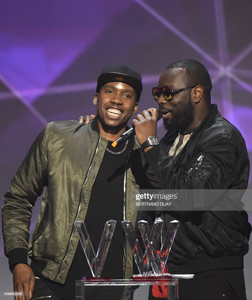 French rapper Gandhi Djuna aka Maitre Gims (R) speaks after receiving the best song award during the 31st Victoires de la Musique, the annual French music awards ceremony, on February 12, 2016 at the Zenith concert hall in Paris. AFP PHOTO / BERTRAND GUAY / AFP / BERTRAND GUAY