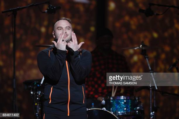 French rapper Julien Marie aka Jul gestures after performing on stage during the 32nd Victoires de la Musique the annual French music awards ceremony...