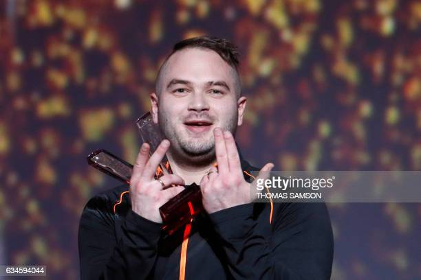 French rapper Julien Marie aka Jul reacts after receiving the best urban music album award during the 32nd Victoires de la Musique the annual French...