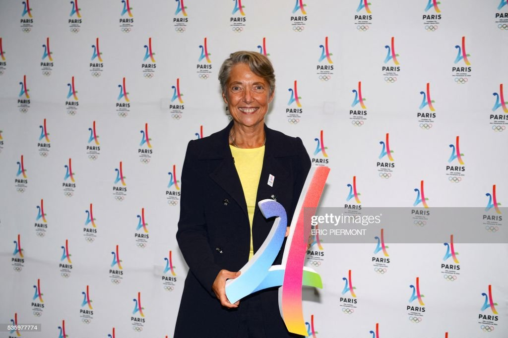 French RATP public transport operator CEO Elisabeth Borne holds a replica of the logo of Paris bid for the 2024 Summer Olympics logo a she poses prior to a meeting gathering French companies and official partners of Paris candidate for the 2024 Summer Olympic games on May 30, 2016 in Paris. / AFP / ERIC