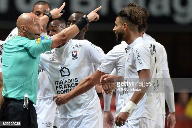 French refere Amaury delerue gestures during the French L1 football match between Stade Rennais and Caen on September 30 at the Roazhon Park in...