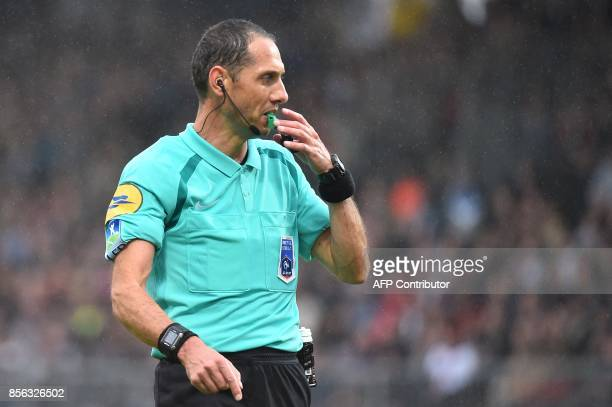 French refere Mikael Lesage blows his whistle during the French L1 football match between Angers and Lyon on October 1 2017 at the RaymondKopa...