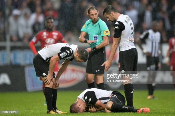 French refere Mikael Lesage talks to Angers' midfielder Thomas Mangani during the French L1 football match between Angers and Lyon on October 1 2017...