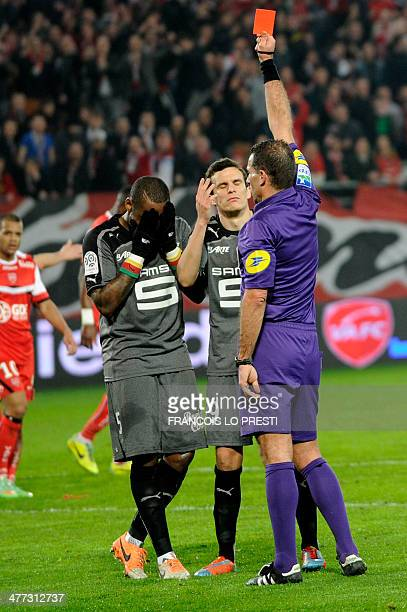 French refere Wilfried Bien gives a red card to Rennes' Senagalese defender JeanArmel KanaBiyik during the French L1 football match Valenciennes vs...