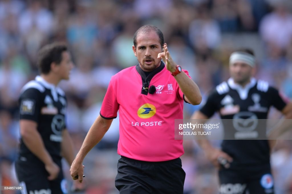French referee Alexandre Ruiz (C) gestures during the French Top 14 rugby union match between Bordeaux-Begles and Brive on May 28, 2016 at the Chaban-Delmas stadium in Bordeaux, southwestern France.
