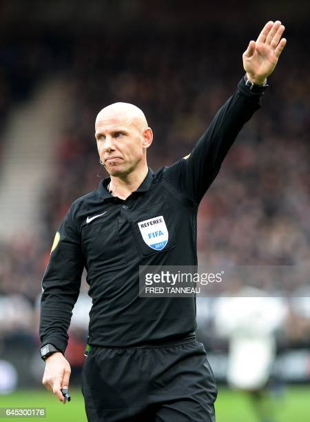 French referee Amaury Delerue gestures during the French L1 football match Guingamp vs Monaco on February 25 2017 at the Roudourou stadium in...