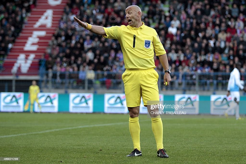 French referee Amaury Delerue gestures during the French L2 football match Caen vs Tours at the Michel d'Ornano stadium in Caen on May 9, 2014.
