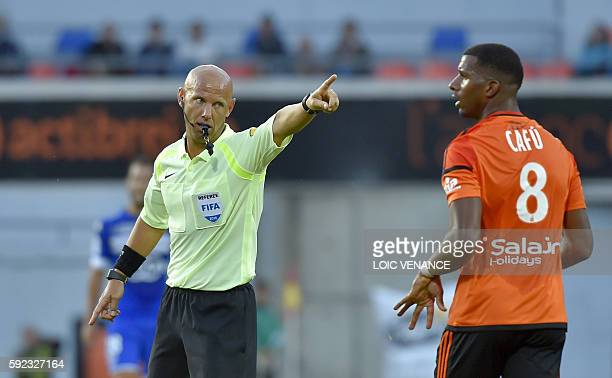 French referee Amaury Delerue gestures to Lorient's Portuguese midfielder Carlos Miguel Cafu during the French L1 football match between Lorient and...