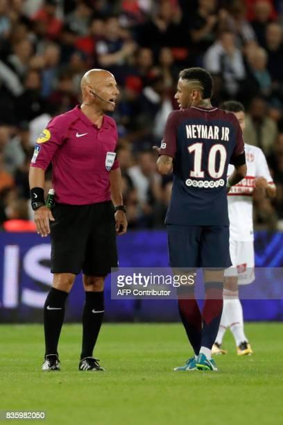 French referee Amaury Delerue talks to Paris SaintGermain's Brazilian forward Neymar during the French L1 football match Paris SaintGermain vs...