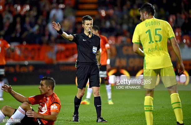French referee Benoit Bastien gestures during the French L1 football match between Lorient and Nantes on October 15 2016 at the Moustoir Stadium in...