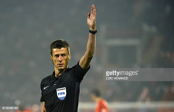 French referee Benoit Bastien gestures during the French L1 football match Lorient vs Nantes at the Moustoir Stadium in Lorient western France on...