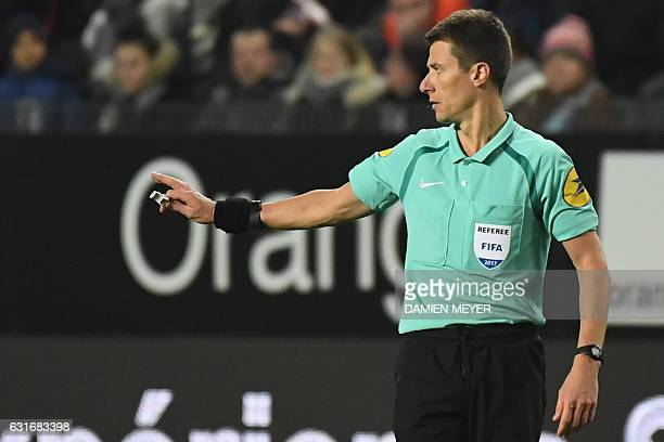French referee Benoit Bastien gestures during the French L1 football match between Rennes and Paris SaintGermain on January 14 2017 at the Roazhon...