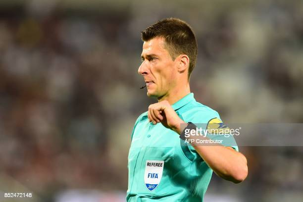 French referee Benoit Bastien reacts during the French L1 football match between Bordeaux and Guingamp on September 23 2017 in Bordeaux southwestern...