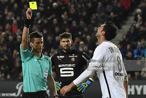French referee Benoit Bastien show a yellow card to Paris SaintGermain's Italian midfielder Thiago Motta during the French L1 football match between...
