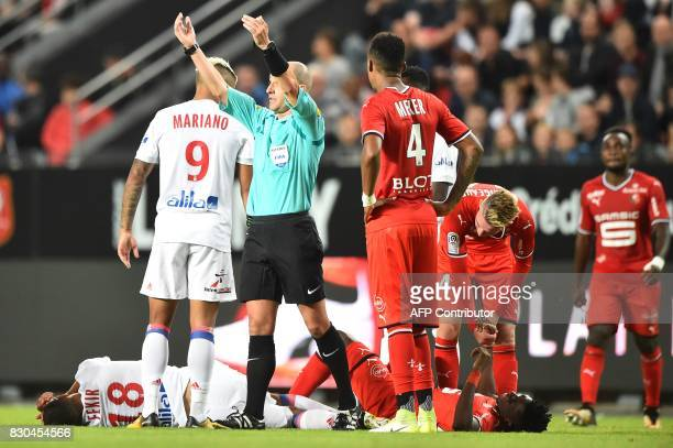 French referee Benoit Millot gestures during the French L1 football match between Stade Rennais and Olympique Lyonnais on August 11 at the Roazhon...