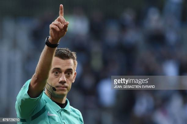 French referee Clement Turpin gestures during the French L1 football match between Lorient and Angers on May 6 2017 at the Moustoir stadium of...