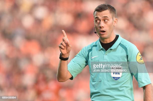 French referee Clement Turpin gestures during the French L12 playoff football match between Lorient and Troyes on May 28 2017 at the Moustoir stadium...