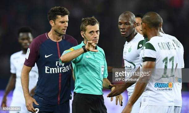 French referee Clement Turpin gestures during the French Ligue 1 football match between Paris SaintGermain and SaintEtienne at the Parc des Princes...