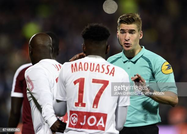 French referee Francois Letexier speaks with Nancy's French defender Faitout Maouassa during the French L1 football match between Metz and Nancy at...