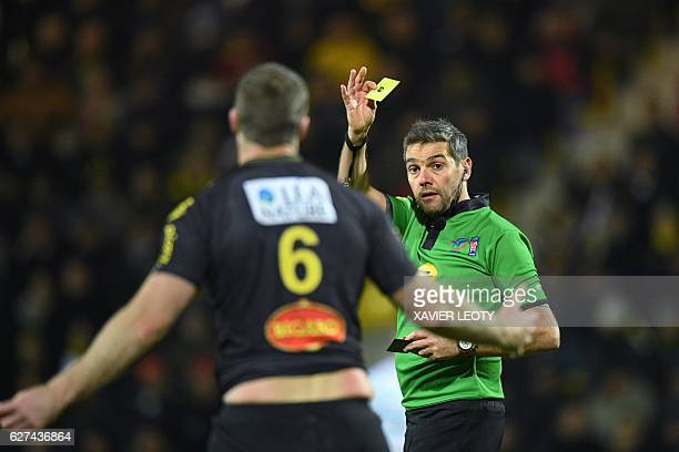 French referee Jerome Garces gives a yellow card to La Rochelle's New Zealand lock Jason Eaton during the French Top 14 rugby union match between La...