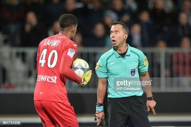 French referee Johan Hamel looks Toulouse's French goalkeeper Alban Lafont during the French L1 Football match between Angers and Toulouse on October...
