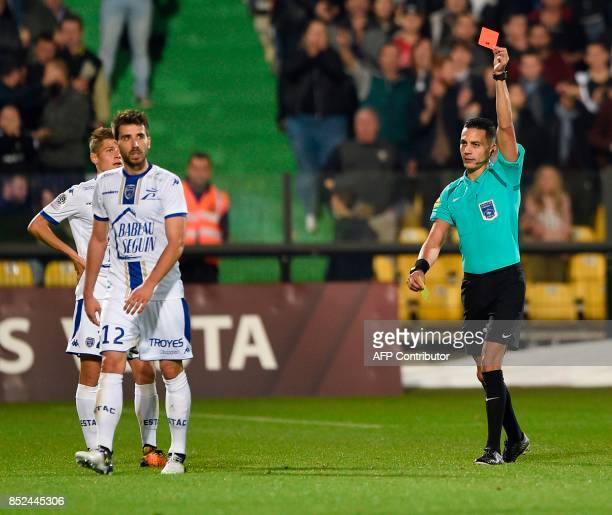 French referee Karim Abed gives a red card to Troyes' French defender Mathieu Deplagne during the French L1 football match between Metz and Troyes on...